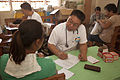 Philippine Air Force Maj. Jonathan Rico, center, a medical officer, examines a Filipino resident during a medical civic action program at the Amungan Elementary School in Amungan, Zambales province, Philippines 130407-M-UY788-048.jpg
