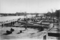 Photo-TokyoAirRaids-1945-3-10-Mass Graves-Sumida River.png