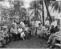 Photograph of reporters and photographers assembled for President Truman's press conference in the garden of the... - NARA - 200553.tif