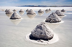 Dry lake - Salt harvesting in Salar de Uyuni, Bolivia, the world's largest salt flat