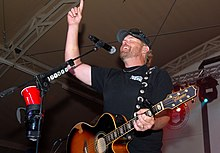 Playing to the base, Toby Keith sings at Camp Buehring during his 'Live In Overdrive' USO tour 120426-A-OQ455-001.jpg