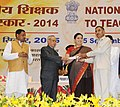 Pranab Mukherjee presenting the National Award for Teachers-2014 to Shri Ashok Kumar Prajapati, Uttar Pradesh, on the occasion of the 'Teachers Day', in New Delhi. The Union Minister for Human Resource Development.jpg