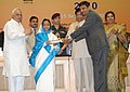 Pratibha Devisingh Patil presenting the National Award for Teacher-2010 to Shri Santosh Kumar Arya, Delhi, on the occasion of the 'Teacher's Day', in New Delhi. The Union Minister of Human Resource Development.jpg