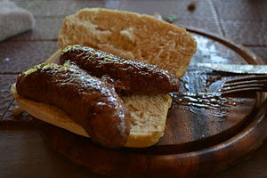 Choripán - Homemade choripán with chorizo sausage recently hot off from an asado grill.