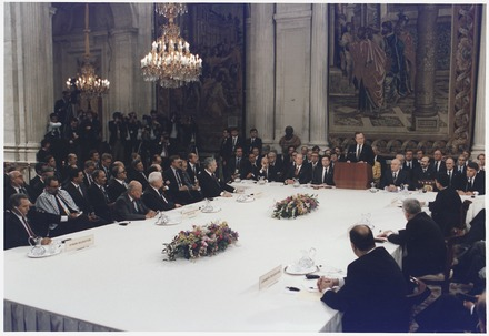 Madrid Conference of 1991 about Israeli-Palestinian peace process with presidents George H. W. Bush and Felipe Gonzalez, among others. President Bush addresses the Middle East Peace Conference at the Royal Palace in Madrid, Spain - NARA - 186439.tif