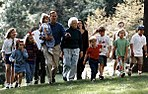 President and Mrs. Bush walk with their grandchildren at Camp David September 19, 1992.jpg