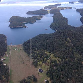 Stuart Island (Washington) - Stuart Island Airpark (background) lies on the eastern shore of Prevost Harbour across from Satellite Island