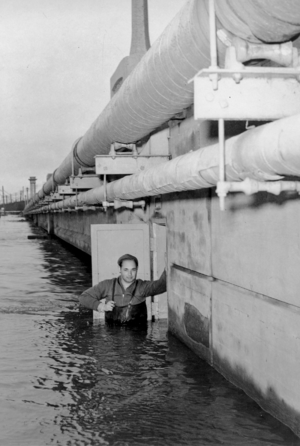 Raritan River - A gauge inspector and the Manville gage house built into Van Veghten's Bridge abutment during the Raritan River flood of December 31, 1948