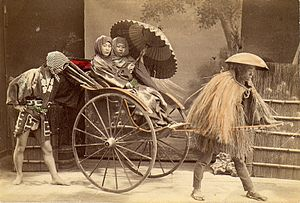 Fleming Museum of Art - Rickshaw driver picking up two clients, circa 1909. This is a photo-postcard from a trip to Japan that Katherine Wolcott and her uncle, Robert Hull Fleming, made in 1909.