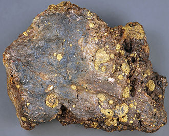 Roasting (metallurgy) - Roasted gold ore from Cripple Creek, Colorado. Roasting has driven off the tellurium from the original calaverite, leaving behind vesicular blebs of native gold.