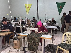 Rojava conflict - Syrians sewing garments in a worker cooperative