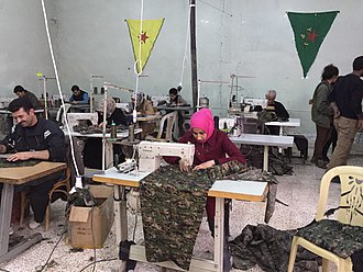 Rojava - The autonomous administration is supporting efforts for workers to form cooperatives, such as this sewing cooperative in Derik.