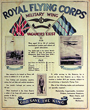 "A poster reads ""ROYAL FLYING CORPS"", ""MILITARY WING"", ""VACANCIES EXIST"", information about pay, ""GOD SAVE THE KING""."