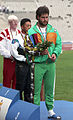 Russell Short on Barcelona 1992 Paralympics medal podium.jpg