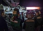 Sailors, family, and friends watching jet engine demonstration on USS John C Stennis (CVN-74) fantail (160807-N-DA693-204).jpg