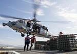 Sailors clear an MH-60S Sea Hawk as it takes off from the flight deck of USS Boxer. (30599801265).jpg