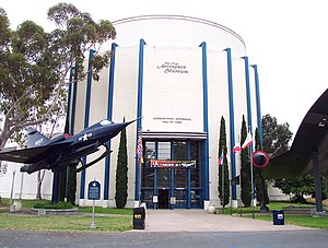 San Diego Air & Space Museum - Museum entrance, showing a Convair YF2Y-1 Seadart on the left and a Lockheed A-12 Blackbird on the right.