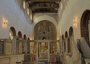 Rood screen - East end of the 8th-century Roman basilica of Santa Maria in Cosmedin showing the altar, under a 13th-century ciborium behind a templon screen of columns. The foreground forms the liturgical choir, surrounded by low cancelli screens, to which are attached two ambos, left and right.