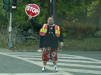 Crossing guard - Crossing guard at a school crossing in the United States