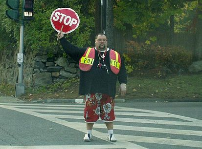 Crossing guard at a school crossing in the United States SchoolCrossing.jpg