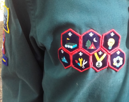 636aca0646c A Scout wearing some of the revised Challenge Badges introduced by The Scout  Association in 2015