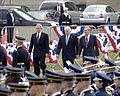 Secretary of Defense Donald H. Rumsfeld (right), accompanied by President George W. Bush and Vice President Dick Cheney, walks onto the Pentagon parade field, Dec 061215-D-WQ296-019.jpg