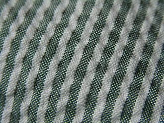 Seersucker - The puckering of the white striped part of the fabric can be seen in close-up