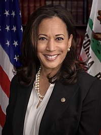 Harris smiling in a pantsuit