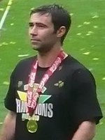 Simon Lappin wearing the Championship winners medal after promotion with Norwich