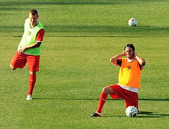 Alberto Aquilani - Martin Škrtel and Aquilani warming up before the game between Liverpool and Roma.
