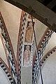 Smn, veduta in basilica dalla cantoria, 07 affreschi trecenteschi su arcone.jpg