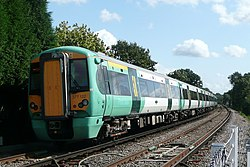 The back of a Southern train leaving Warnham station in West Sussex, as it heads for Horsham railway station