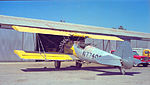 Stearman N2S-4 Sprayer at the University Airport, Davis, CA, in August 1964. A real working crop duster. Note there is no instrument panel. THere are some up in the center section of the top wing. (14009293919).jpg