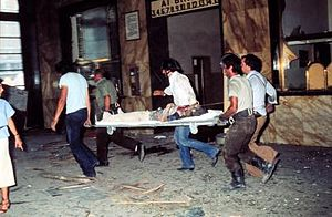 Bologna massacre - Rescuers carrying a victim.