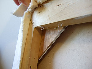 Strainer bar - Backside view of a strainer frame displaying corner construction.