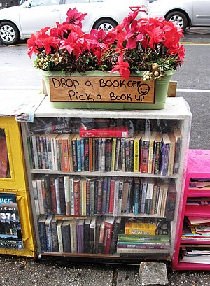 "Book swapping - A ""street book exchange"" in Washington Heights, New York."