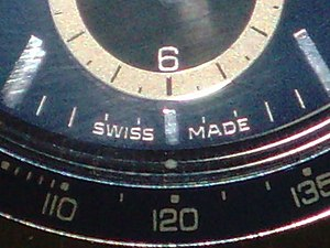 "Country of origin - ""Swiss Made"" label on a TAG Heuer chronograph."