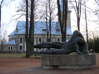 Tapa, Estonia - Son of Kalev statue in front of St. Jacob's Church.