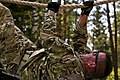 Tech. Sgt. Joe Lovanisci climbs the inverted rope challenge July 17, 2014, on an obstacle course at the Grafenwoehr Training Area, Germany.jpg