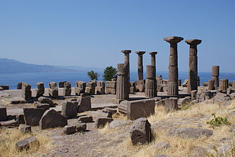 Assos - Temple of Athena in Assos, with the nearby island of Lesbos at left.