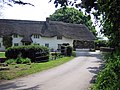 Thatched house at Winterborne Zelston - geograph.org.uk - 294703.jpg