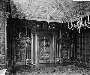 The Grange, Broadhembury - 1921 photograph of panelling in the drawing room of The Grange, now in the Speed Art Museum in Louisville, Kentucky, USA. The relief sculpted panels on the doors depict scenes from Ovid's Metamorphoses