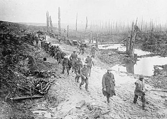 Poplar and Stepney Rifles - Men of the 17th (County of London) Battalion, London Regiment (Poplar and Stepney Rifles), 47th (2nd London) Division, crossing a muddy area in the Ancre Valley, October 1916. (IWM Q1561)