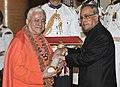 The President, Shri Pranab Mukherjee presenting the Padma Shri Award to Jagat Guru Amrta Suryananda Maha Raja, at a Civil Investiture Ceremony, at Rashtrapati Bhavan, in New Delhi on April 08, 2015.jpg