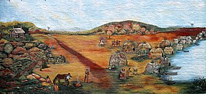 """Oswego, Kansas - Several murals can be found around the city. The most famous is this reproduction of E. Marie Horner's """"The Village of White Hair"""" depicting the relationship between white trader John Mathews and the Osage, led by Chief White Hair."""
