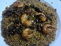 Thiebou kethiakh (riz au poisson fumé) avec fruits de mer (gambas, huitres) et haricots.jpg