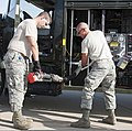 U.S. Air Force Airman Kyle O'Brien and Airman Kyle Coates, both with the 364th Training Squadron, rewind a servicing hose onto an R-11 jet fuel truck during refueling training at Sheppard Air Force Base 110712-F-NS900-004.jpg