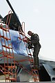 U.S. Army Col. Scott Patten climbs into an SU-27 Flanker aircraft at Mirgorod Air Base, Ukraine, July 21, 2011, during Safe Skies 2011 110721-A-VM449-117.jpg
