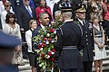 U.S. Army Sgt. 1st Class Tanner Welch, center, assigned to the 3rd U.S. Infantry Regiment (The Old Guard), helps President Barack Obama lay a wreath during the 145th annual Memorial Day ceremony at the Tomb 130527-D-HU462-150.jpg