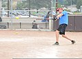 U.S. Coast Guard Chief Petty Officer Jeffrey Schmitt, a search and rescue controller at the 9th Coast Guard District Command Center in Cleveland, gets a hit during his unit's softball practice July 31 130731-G-KB946-013.jpg
